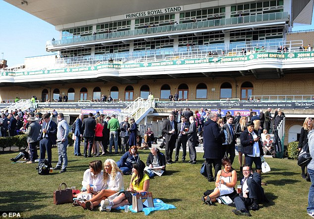 Nice day for a picnic: The sun was out at Aintree on Saturday morning