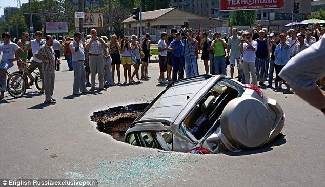 The city of Samara in Russia appears to be sinking into the earth, as massive sinkholes open up swallowing cars and wreaking havoc