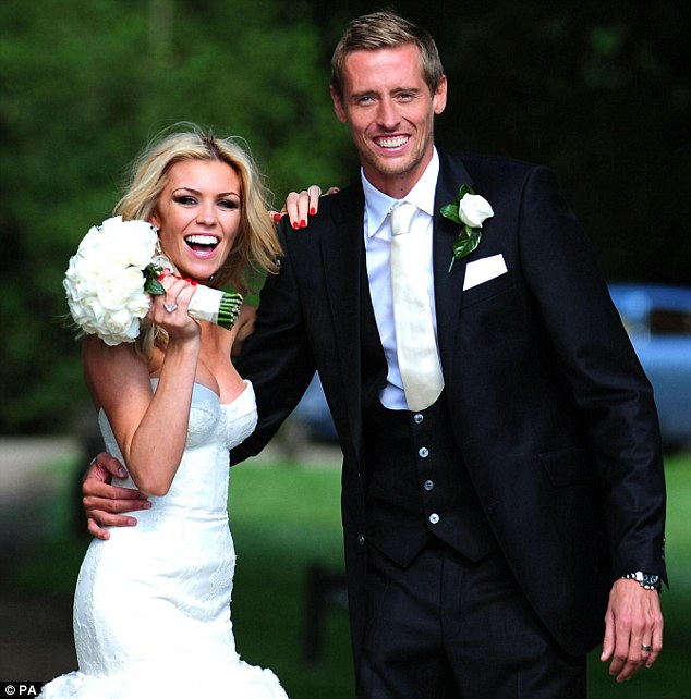 Happy couple: Peter and Abbey Crouch on their wedding day