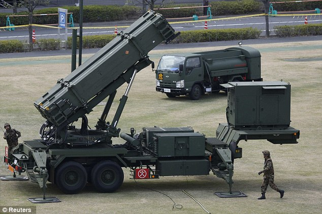 Primed: Japan mobilised its tropps as it was claimed by U.S. and South Korean sources that at least one previously untested missile with a 3,000km (2,000-mile) range is fuelled and ready for launch