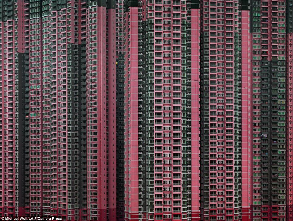 Architecture of Destiny: This image of a pink tower block soaring high into the skies above Hong Kong could almost be mistaken for a piece of abstract art