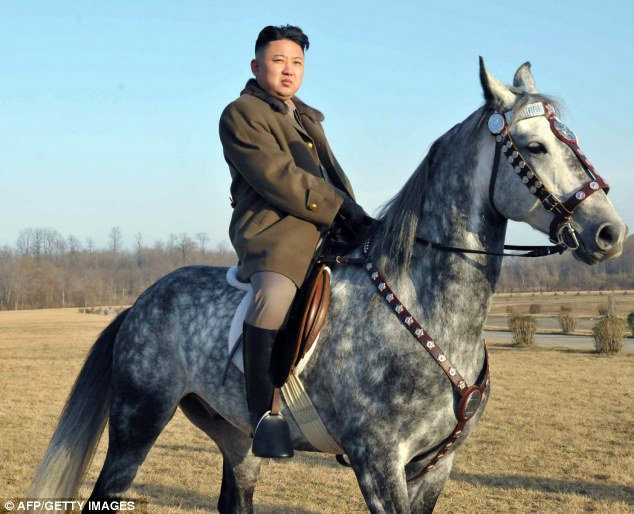 High and mighty: North Korean dictator Kim Jong Un inspecting troopers at a cavalry training compound in a picture released by the regime's press agency