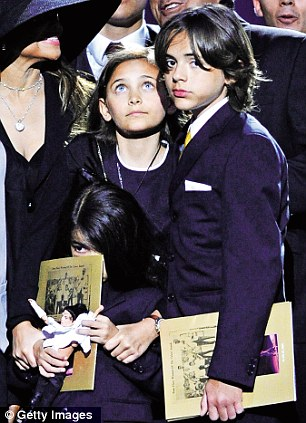 Paris and Prince, with Blanket in front, at the memorial service held for their father in July, 2009 in Los Angeles
