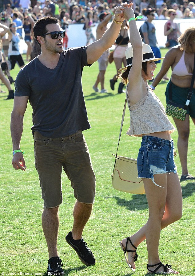 Swing time: Dallas actor Jesse Metcalfe twirled girlfriend Cara Santana as they danced to the beat
