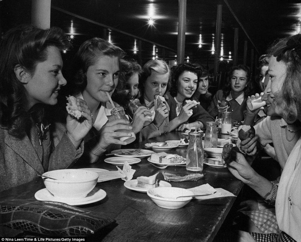 Dining out: A group of teens enjoy some fruit, cake and milk in one of Leen's images from 1944