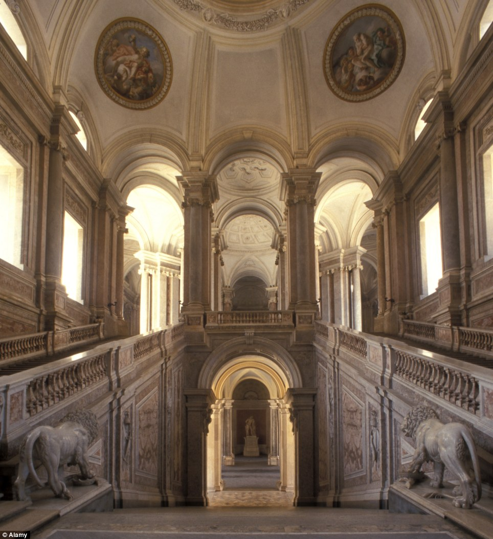 The artworks inside the former royal palace, such as these at the 'Great Staircase of Honour' may be at risk, according to the mayor of Caserta