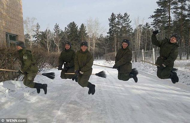 Snow gravity: These Russian soldiers high on life... and brooms