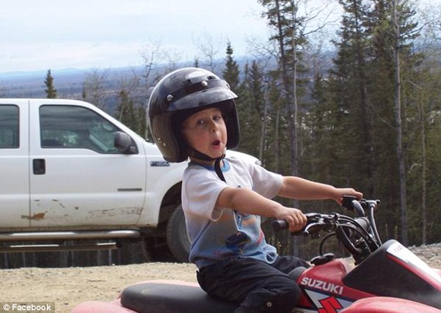 Racer: The young snowmobile racer, pictured, had been riding the machine with his father at the Arctic Man Classic and Sno-Go - a major snowmobile and ski race in the Hoodoo Mountains in central Alaska