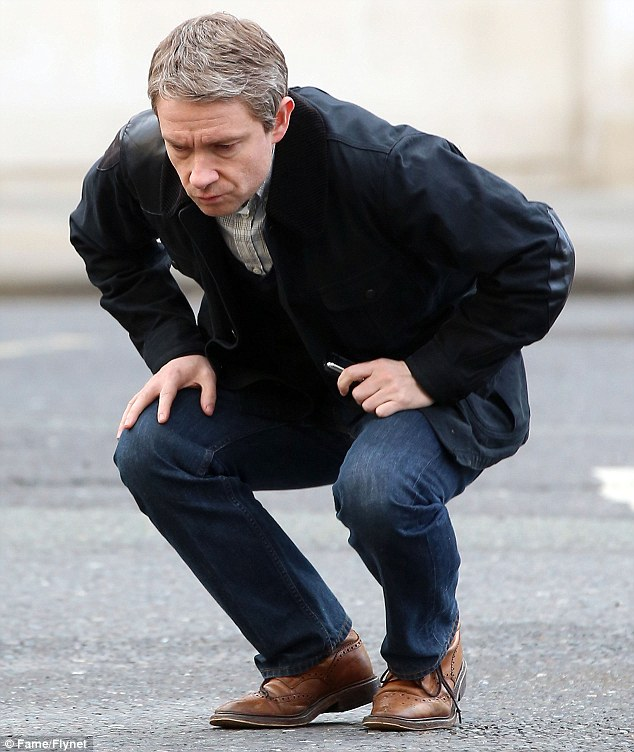 Weakened: Martin Freeman crouches down, unsteady on his feet