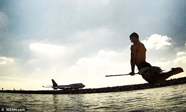 Plane crazy: This Quidditcher has found some competition. Wonder who would win in a flight?