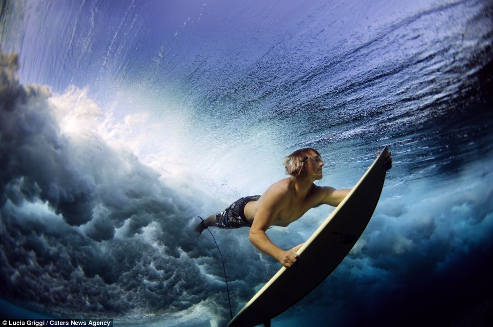 Breathtaking: A surfer dives under the crushing breaking waves during the the Volcom Pro competition in Fiji