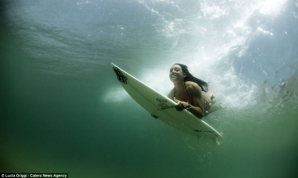 World's best: The world's best surfers - as well as the sport's top photographers - came from all four corners of the globe for the competition off the coast of Fiji