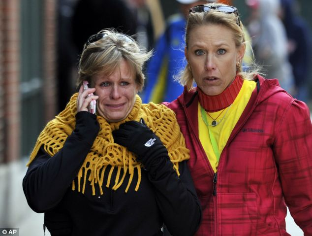 Concern: Women react as they walk from the area where there was an explosion after the Boston Marathon
