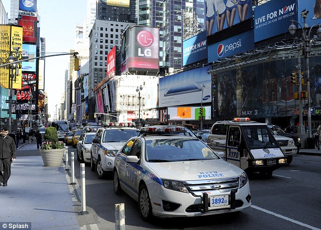 Row of NYPD patrol cars line the streets of Times Square as a show of force