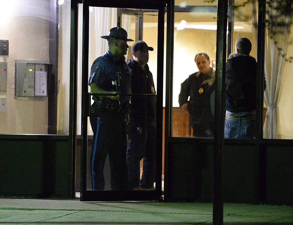 'Person of Interest': Police investigators leave an apartment complex in Revere, Massachusetts, USA, on 16th April 2013