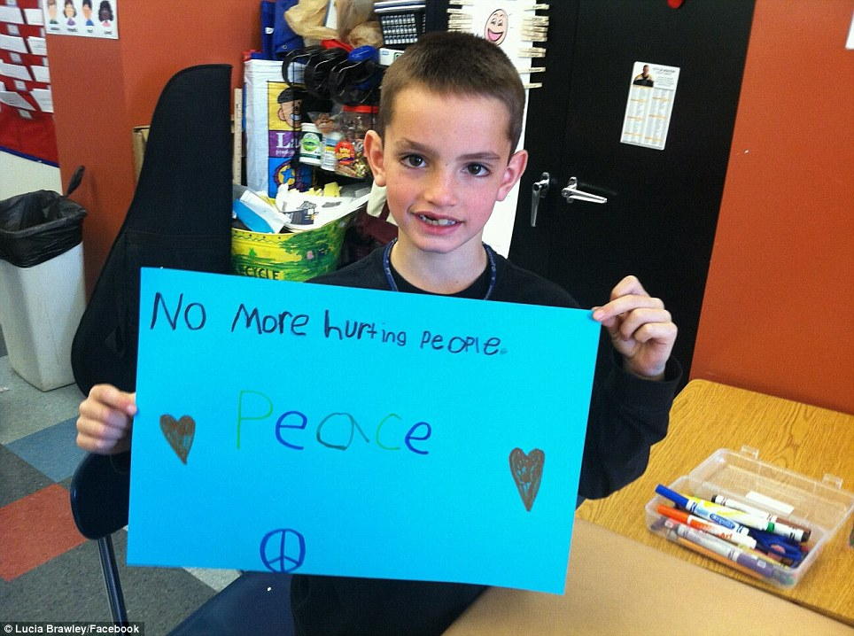Killed: Eight-year-old Martin Richard from Dorchester, Massachusetts was among the three people killed when two bombs detonated at the Boston Marathon on Monday