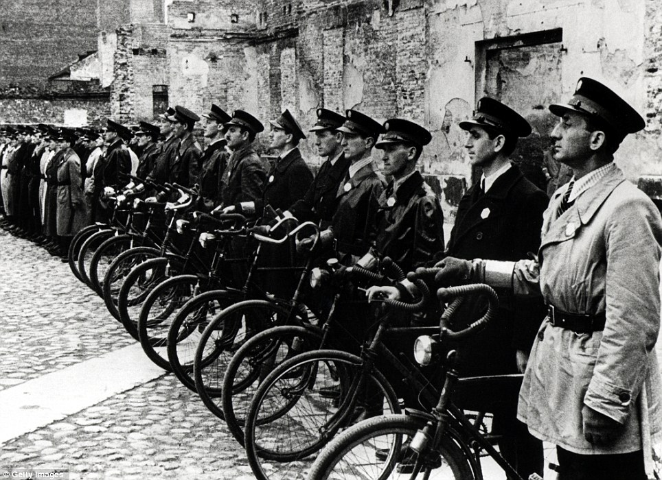 Keeping watch: Officers of the Jewish Ghetto Police or Jewish Order Service in the Warsaw Ghetto, who were an auxiliary police unit operating under Nazi jurisdiction