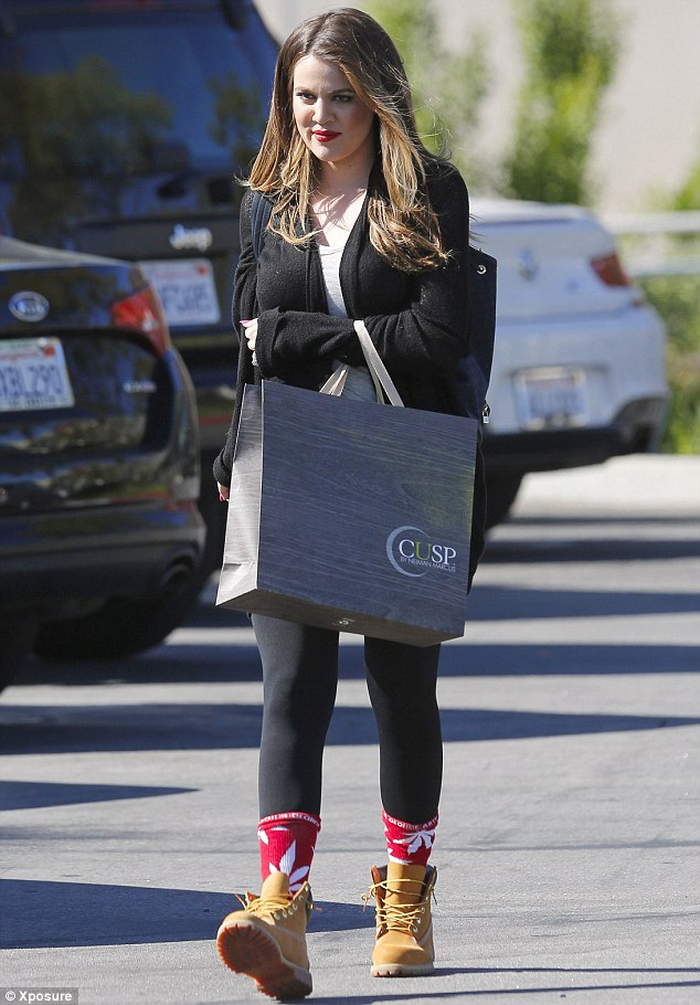 Family on her mind Khloe Kardashian wears brother Robs