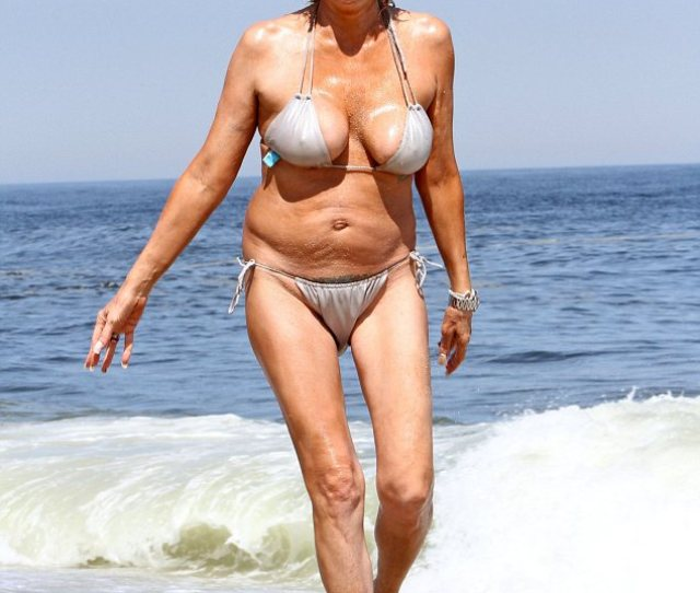 Busting Out The  Year Olds Bikini Struggled To Contain Her Curves And