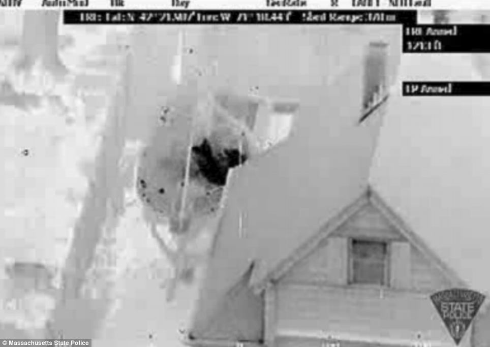 In hiding: The dramatic footage released by police shows where the teenager lay hiding in a boat in the quiet suburban neighbourhood of Watertown