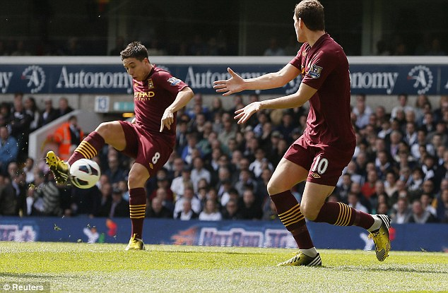 Good finish: Samir Nasri tucks in the opening goal for Manchester City after five minutes