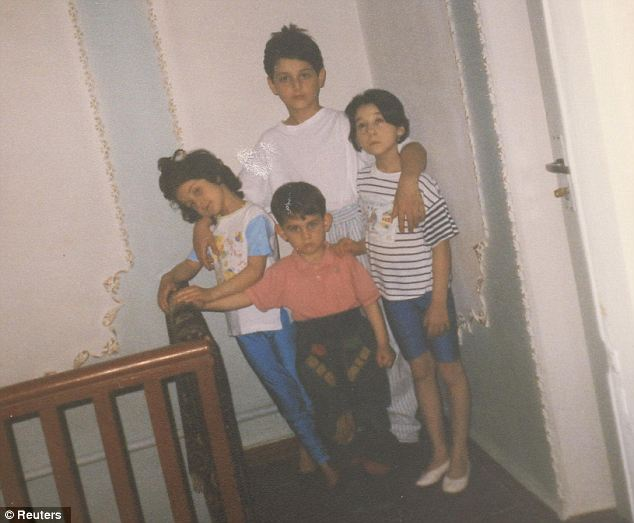 Patimat Suleimanova, aunt of the suspected bombers, shared this photo of a young Dzhokhar (C, bottom) and Tamerlan (C, top) with their sisters about 15 years ago