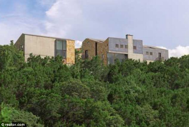 Fortress: Lance Armstrong's new $4.3million hill-top home overlooking Lake Austin, which he bought last week, has been described as a 'fortress for staving of the Zombie Apocalypse'