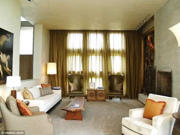 A place to relax: The living room is fully kitted out with comfortable sofas and antique-looking furniture