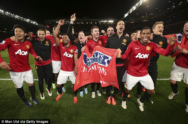 Champions of England: The Manchester United squad celebrates after clinching their 13th Premier League title