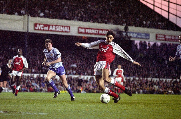 Good old Arsenal: Alan Smith scores against Manchester United in 1991 after winning the title as Steve Bruce watches on