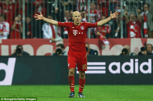 Three and easy: Arjen Robben celebrates scoring the third goal against Barca