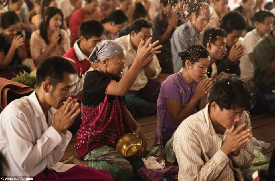 When the ceremony is finished and the children become monks, parents throw popcorn, candy and coins into the air