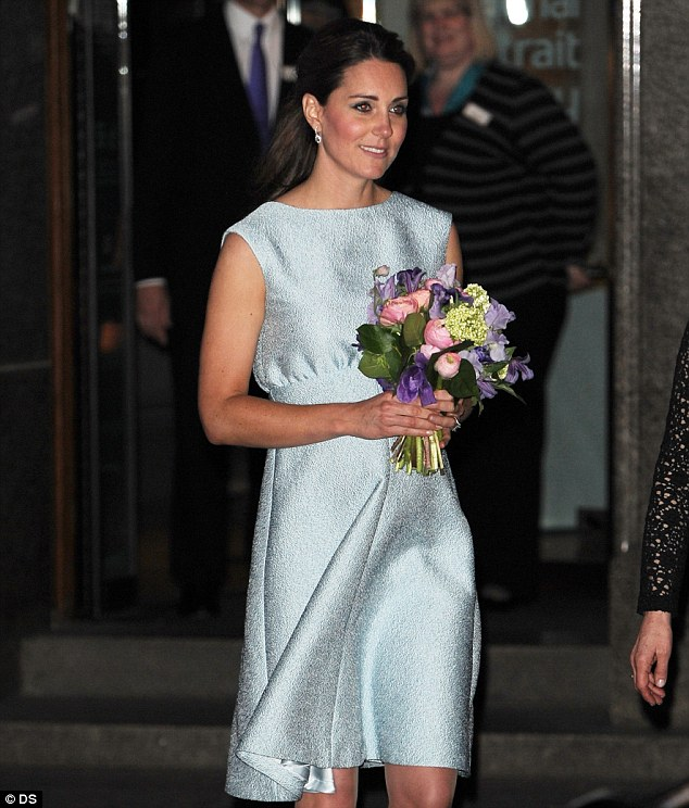 Blooming: Kate carried a bouquet of flowers as she left