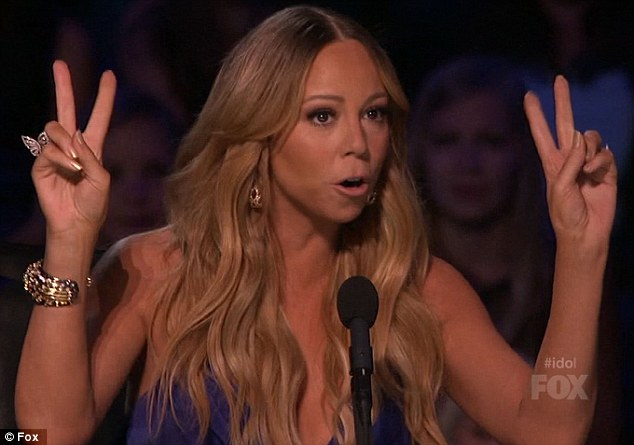 V for victory: Mariah Carey had reason to celebrate on American Idol on Wednesday night after apparently beating off a bid to bring back Jennifer Lopez in her place