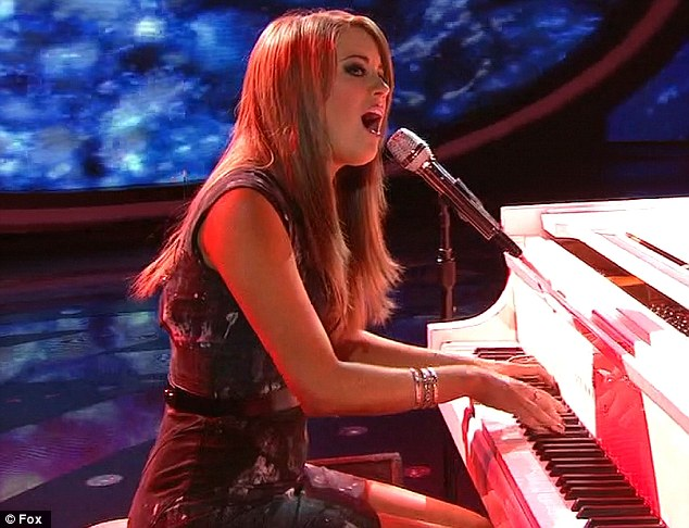 Lovely pianist: She looked glamorous as she tinkled the ivories thanks to her snazzily designed dress
