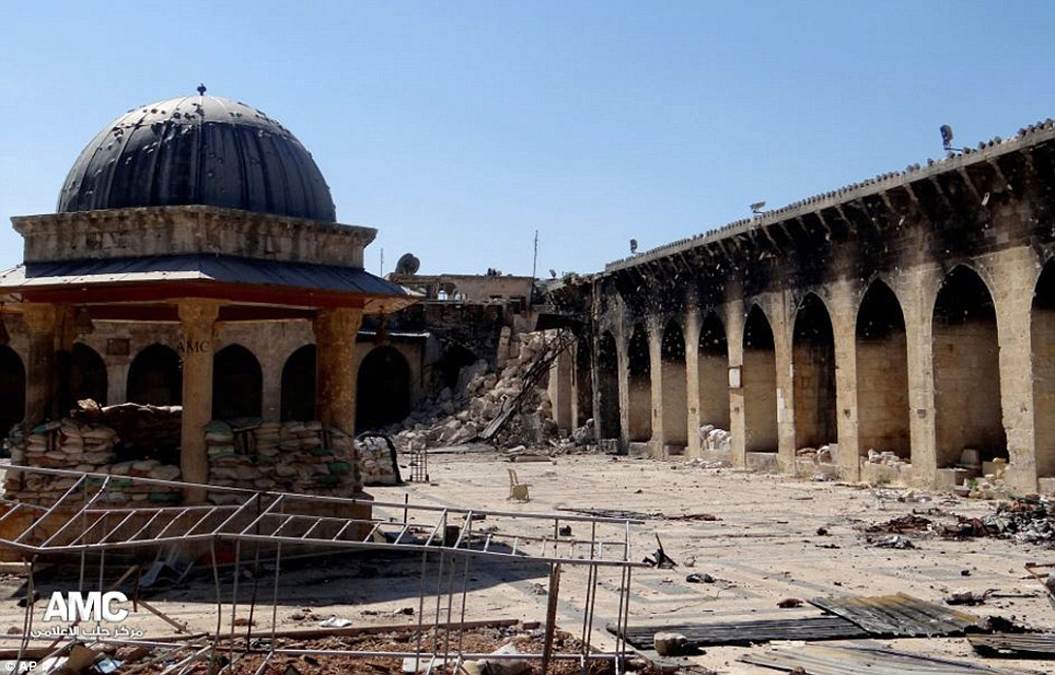 Wrecked: The rubble-strewn remains of the 12th century Umayyad Mosque in Aleppo which has been devastated by heavy shelling