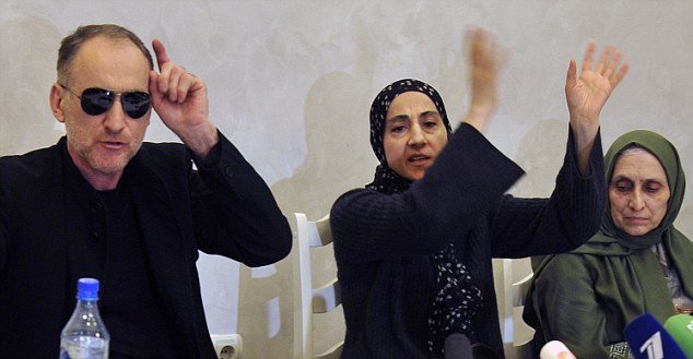 Enraged: Anzor Tsarnaev and his wife Zubeidat gesture at the gathered journalists at the press conference alongside the suspects' aunt Patimat Suleymanova