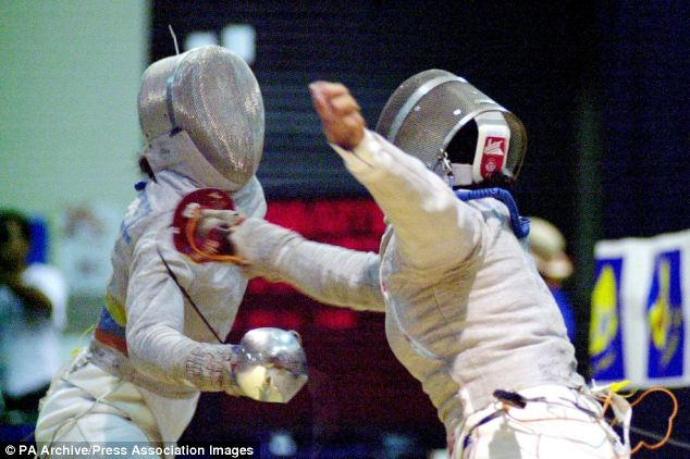 In action: Alejandra Benitez takes part in a fencing match at the Central American and Caribbean Games in San Salvador, El Salvador in 2002