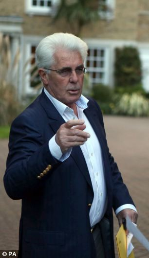 Max Clifford (pictured speaking to media yesterday outside his home in Surrey) has been charged with 11 counts of indecent assault