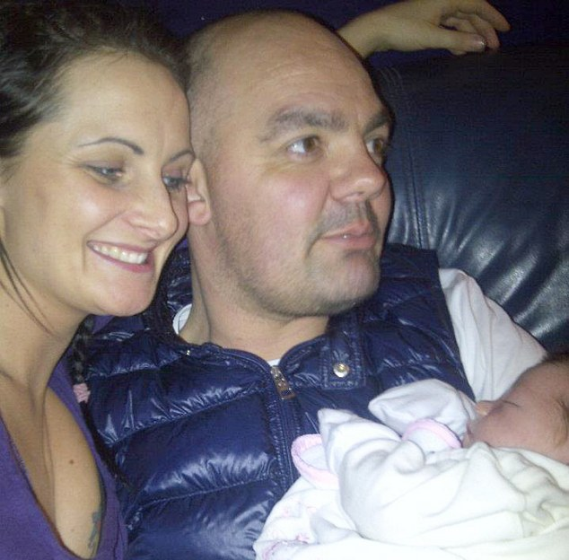 Family man: Father-of-two Anthony Grainger, 36, pictured with his partner Gail and a relative's baby, was shot to death by police weeks after he was cleared of suspicion of stealing a memory stick of sensitive information