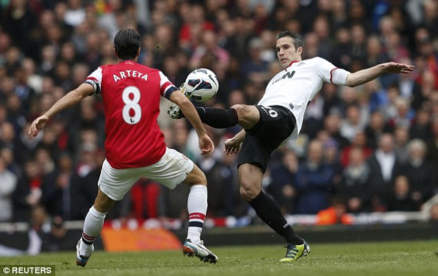 Dutch of class: Van Persie (right) teases Mikel Arteta by bringing the ball down with aplomb