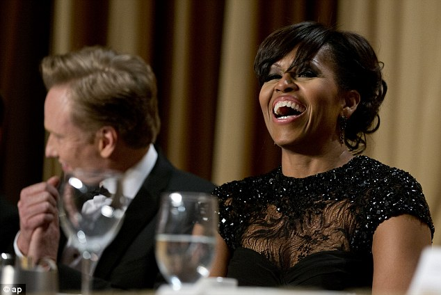 Laughter: US first lady Michelle Obama enjoyed her husband's speech and game-fully took the jokes at her expense