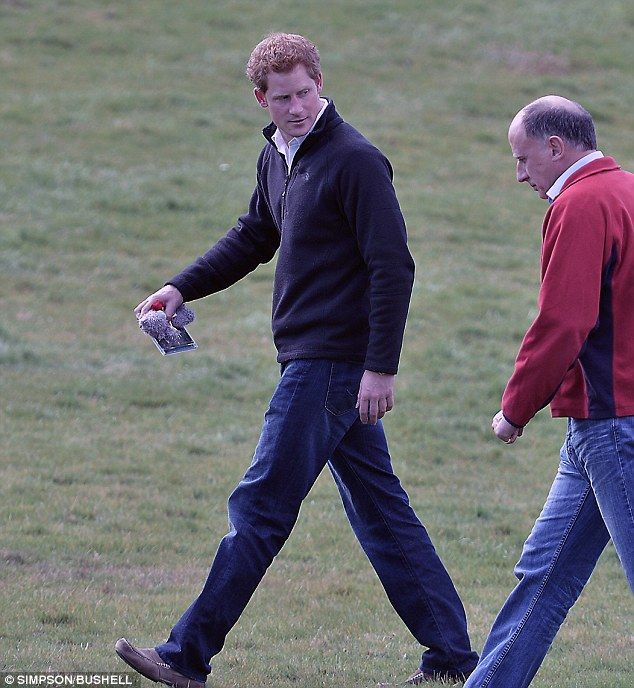 True to his word: Prince Harry pictured holding the blue bear he promised to give to his unborn niece or nephew