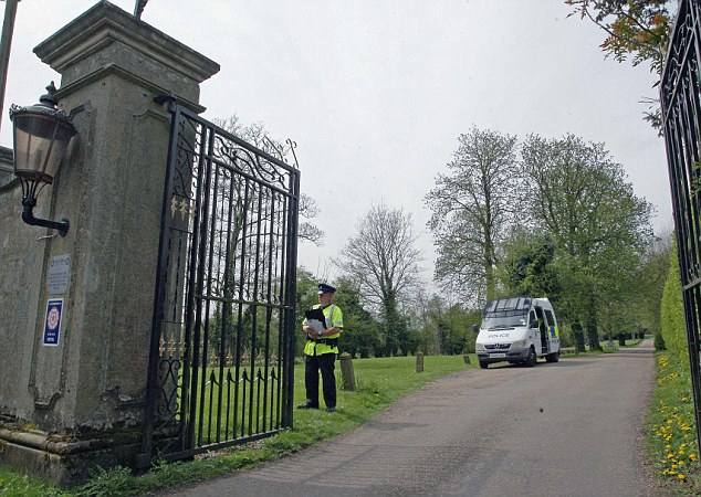 A policeman stands guard at the Down Hall Country House Hotel in Essex, where the couple were discovered dead in the swimming pool on Saturday night
