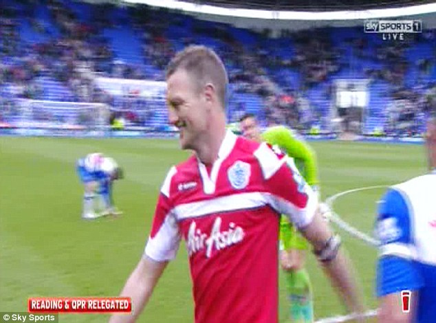 You too: Clint Hill was also grinning after the two sides were condemned to the Championship