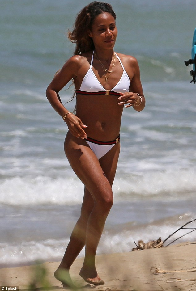 Swimsuit stunner! The wife of Will Smith donned the bravest of swimsuits - a white bikini