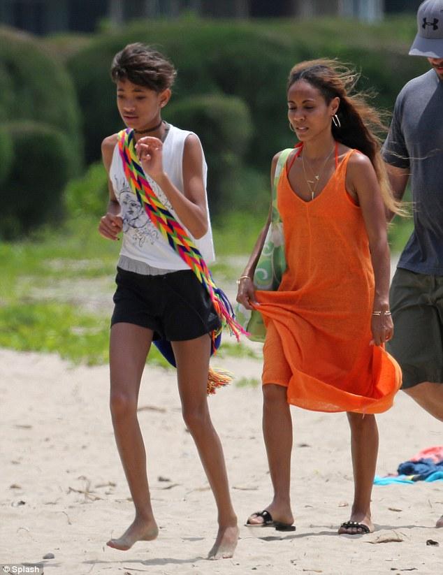 Beach daze: Willow soaked up the sun on the beach with Jada