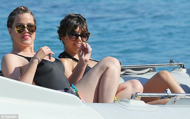 Lookalikes: Khloe showed off her curves in a black swimsuit similar to Kourtney's