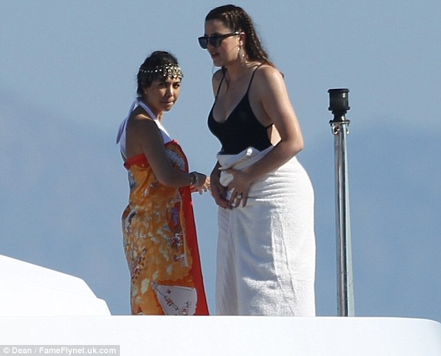 Drying off: She then wrapped up in a towel to join her sister Kourtney Kardashian on their luxury yacht