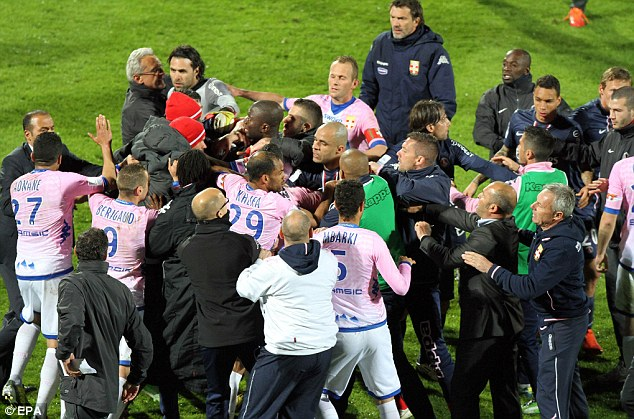 Tempers: Players from both sides engaged in a brawl after the final whistle
